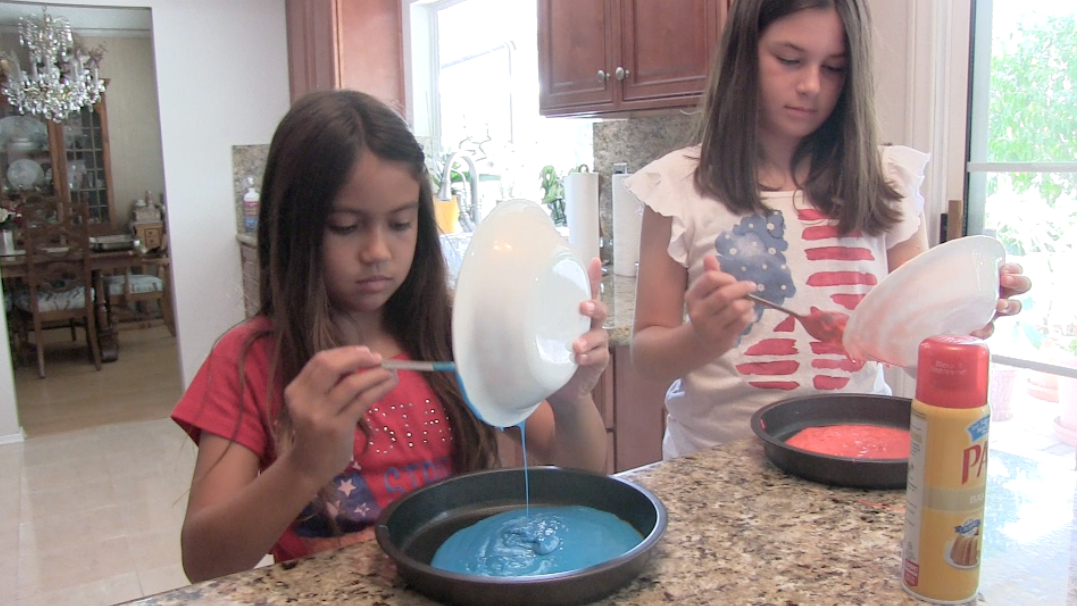 Pouring the colored batter into the pans
